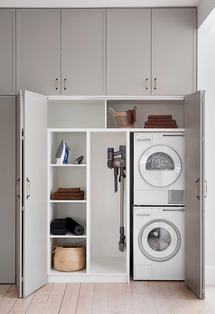 **Euro style** Melbourne-based Alison Lewis Interiors designed this stylish cleaning station behind bifold doors.