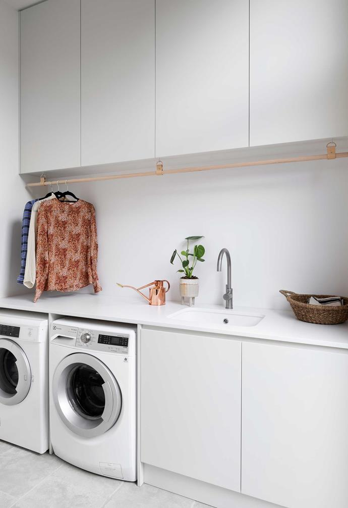 **Double duty** Installing efficient yet chic hanging rails in laundries can be the ultimate cheat to reduce ironing time.