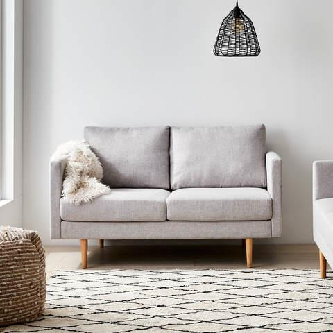 """Snuggle up on the Scandi-style grey[Harrison 2 Seater Sofa](https://www.kmart.com.au/product/harrison-2-seater-sofa/3380818