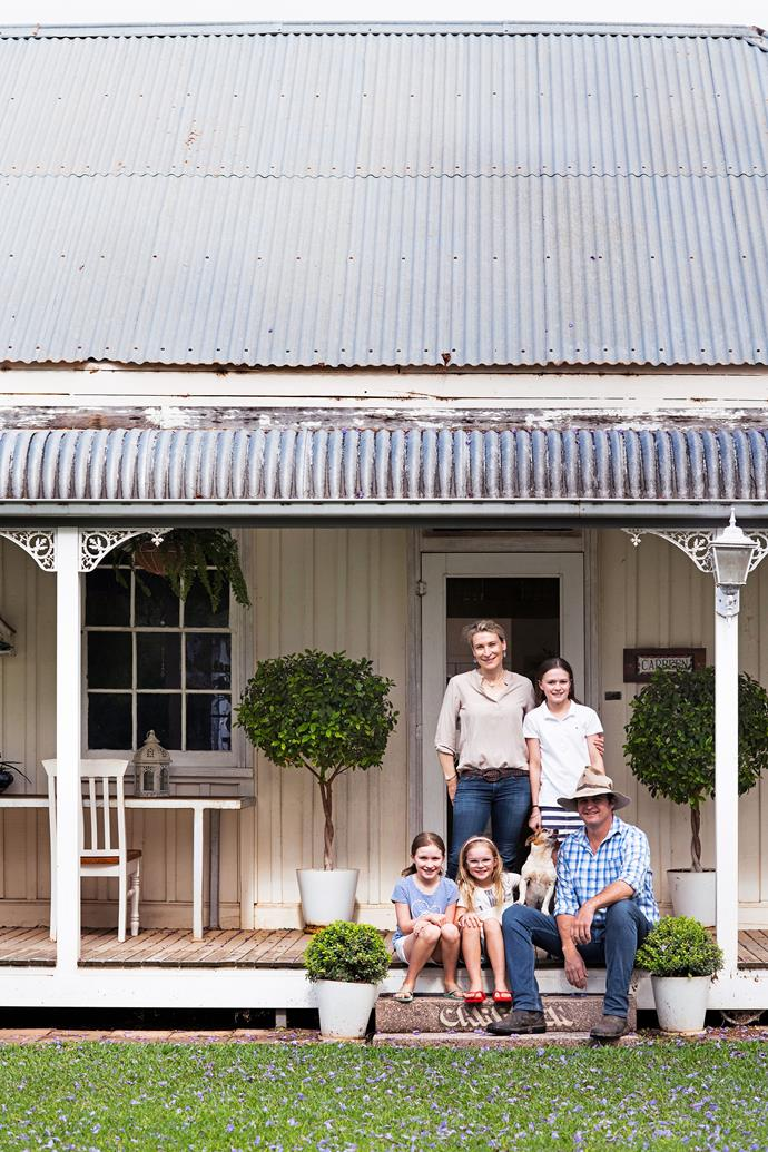 Owners Keiran and John Knight with their daughters Audrey (top), Sabrina (left) and Kitty (right), and Bonnie, the Jack Russell.