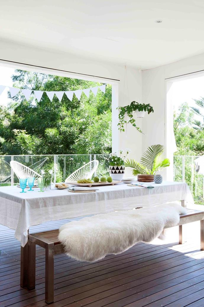 """Add a [sheepskin throw](https://www.homestolove.com.au/sheepskin-winter-home-decor-21380 target=""""_blank"""") to elevate your alfresco entertaining in the colder months, like this [incredible garden design](https://www.homestolove.com.au/creative-garden-design-ideas-22006 target=""""_blank"""") set up."""