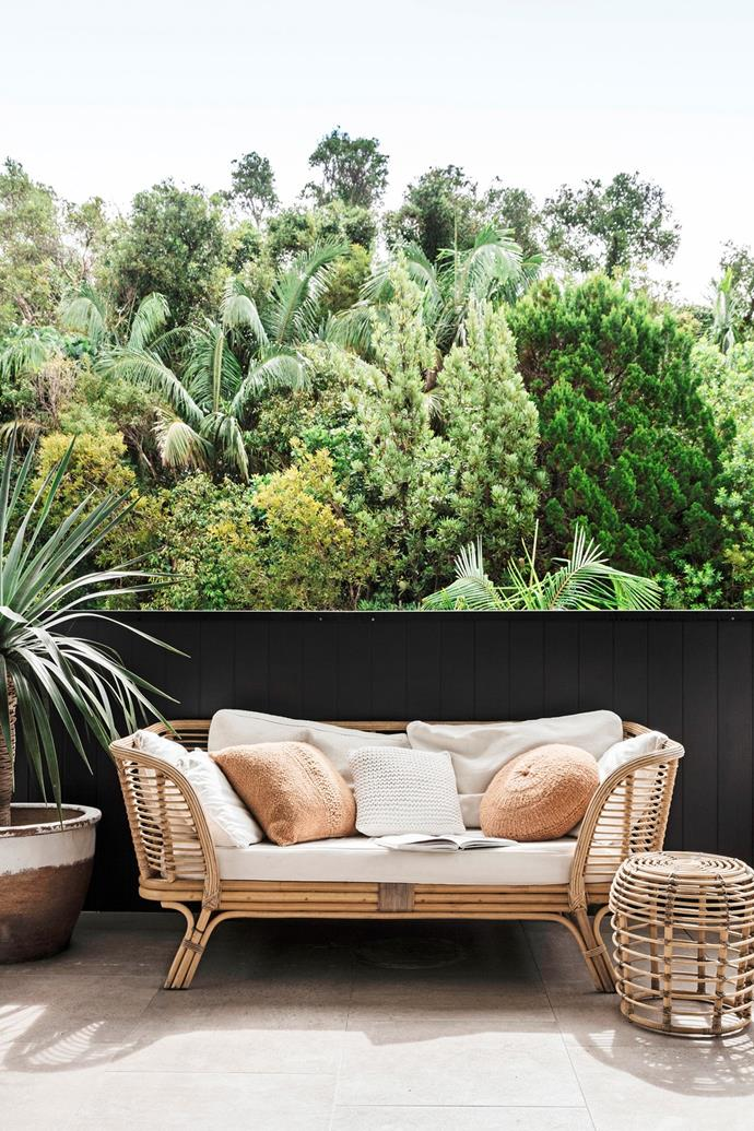 """With its comfy wicker daybed, the balcony of this [modern coastal home](https://www.homestolove.com.au/modern-coastal-interior-ideas-20679 target=""""_blank"""") is the ideal spot to sit, relax and admire the glorious hinterland views."""