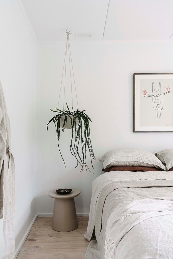 Minimal, natural furnishings create an elegant yet cosy feel in the bedroom.