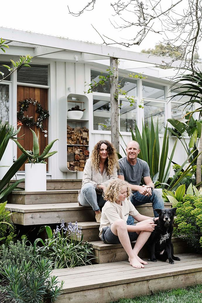 Bec, Marcus, Monty and dog Macca, sitting on their front steps.