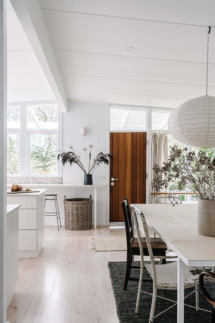 """Abundant light from two walls of windows makes the """"modern beach shack"""" an inviting space - especially for """"first morning coffee,"""" says Bec."""
