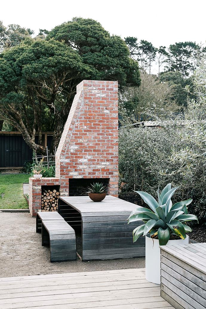 """""""We put a chimney outside so when we have friends over it's t his warm, inviting place to relax,"""" says Bec. The garden furniture, outdoor light sculpture and wood stackers are from [Unearthed Garden](https://www.unearthedgarden.com.au/