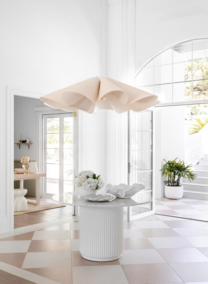 Entry doors and arched windows, Trend Windows & Doors. Porto Pablo dining table, Oz Design Furniture. Delfina pendant light, Enlightened Living. Reef bowl, Freedom. Pompeii bowl, Provincial Home Living. Byron sheer curtains, Luxaflex Window Fashions.