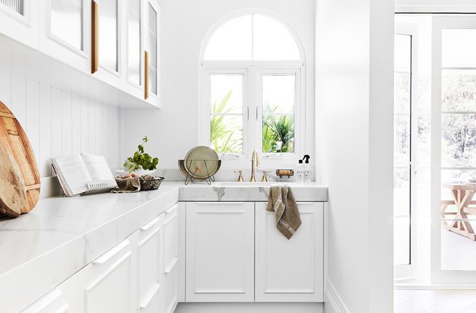 Moisture-resistant Axon cladding from James Hardie is used for the splashback. Posh Canterbury hob kitchen set, Reece. Dish rack, The Society Inc. Tea towel, Crave Wares. Window, Trend Windows & Doors.