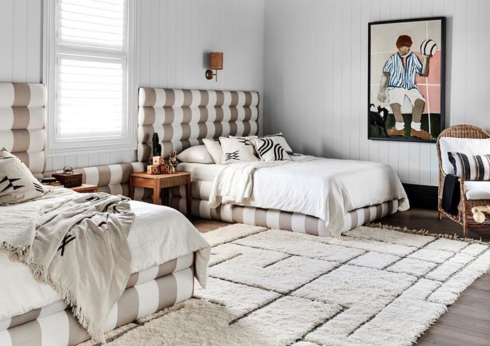 Artwork by Kerrie Jeffs. Custom beds, Create Estate. Tide wall light, Beacon Lighting. Iceland bedside tables, Satara. Capri lounge chair, Provincial Home Living. Beni Ourain rug, Benisouk. Axon cladding, James Hardie
