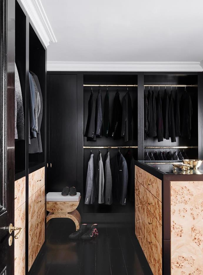"""Custom joinery in poplar burl veneer creates a moody, masculine aesthetic in the spacious wardrobe room in this [contemporary yet timeless home in Toorak](https://www.homestolove.com.au/modern-yet-timeless-home-built-on-narrow-site-toorak-22228