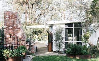 Exterior of a white, renovated mid-century home in Flinders, VIC