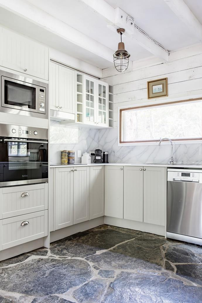 While many original features of the cabin were retained, Marlon and Rom installed a brand new kitchen complete with stainless steel appliances and a coffee machine.