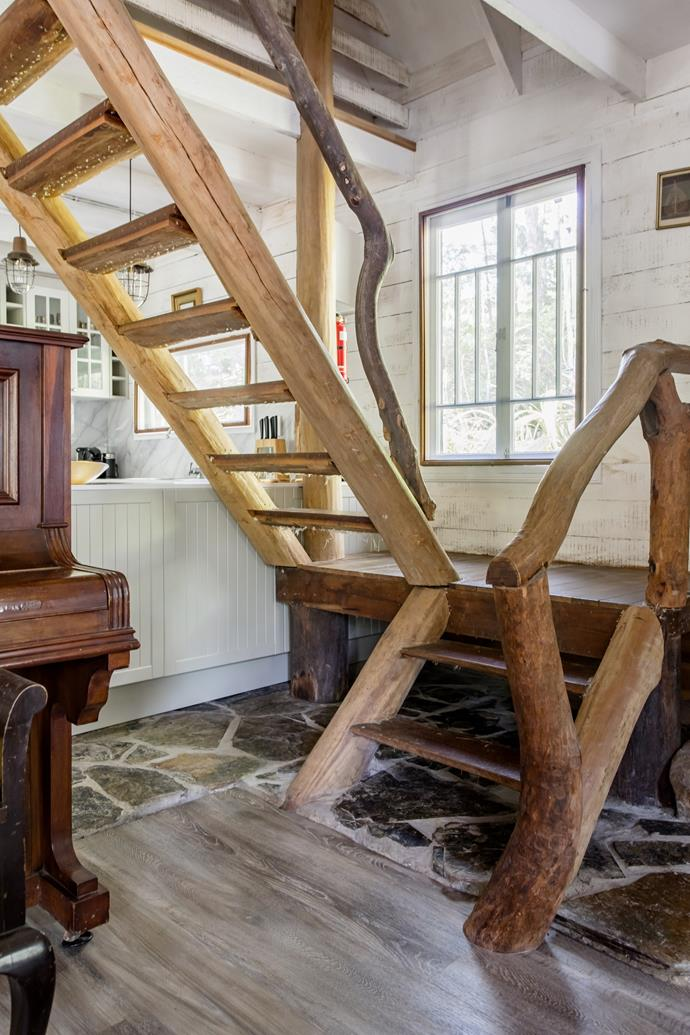 The rough-hewn staircase harks back to the home's history as a cottage for timber cutters in the 1930s.