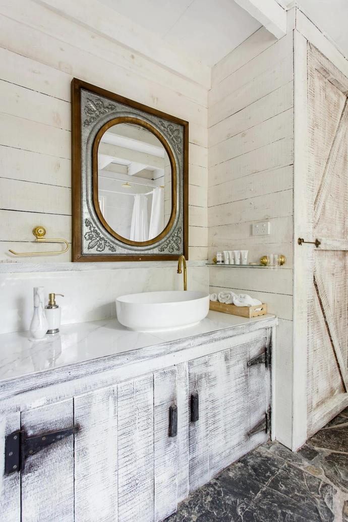 The bathroom strikes the right balance between modern and vintage rustic.
