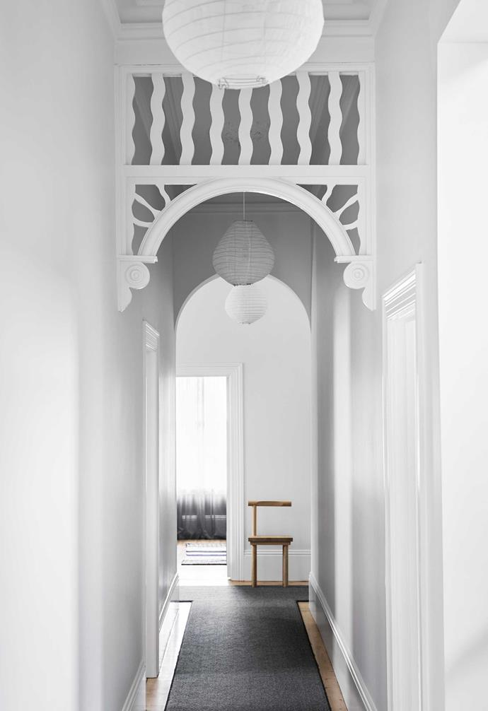 "**Hallway**The original fretwork was given a fresh coat of paint in [Dulux](https://www.dulux.com.au/|target=""_blank""|rel=""nofollow"") Natural White. Kristina Dam Studio 'Sculptural Chair', [Designstuff](https://www.designstuff.com.au/|target=""_blank""|rel=""nofollow"")."