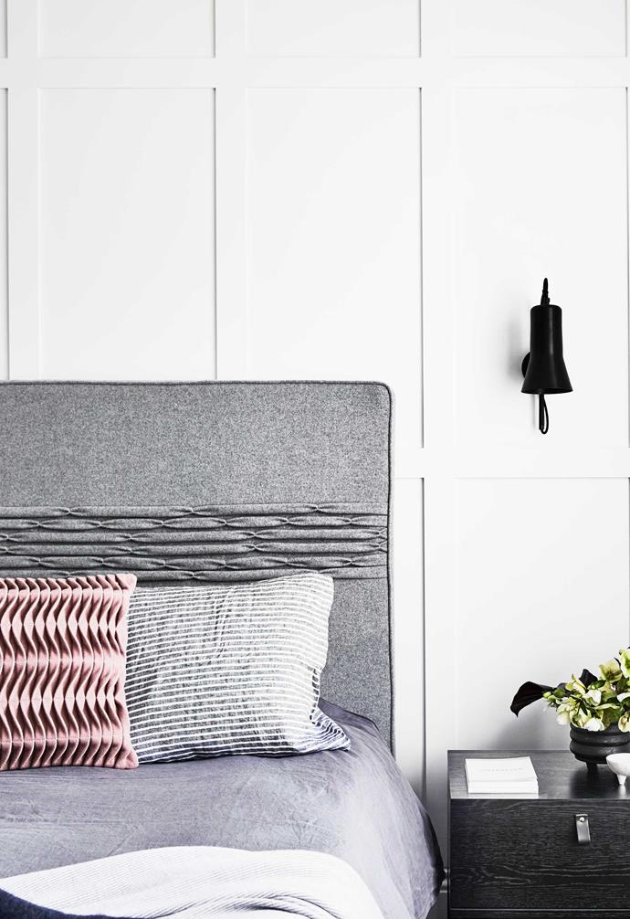 """**Main bedroom** The panelled wall makes a bold statement. Cushions from [Figgoscope Curates](https://www.figgoscope-curates.com/