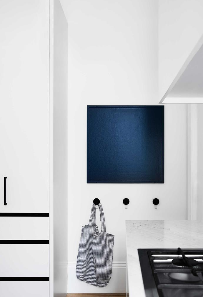 """**Kitchen** A chalkboard above Dial hangers from [Design By Them](https://www.designbythem.com/