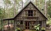 A secluded rainforest cabin in Bonogin, QLD restored by DIY renovators