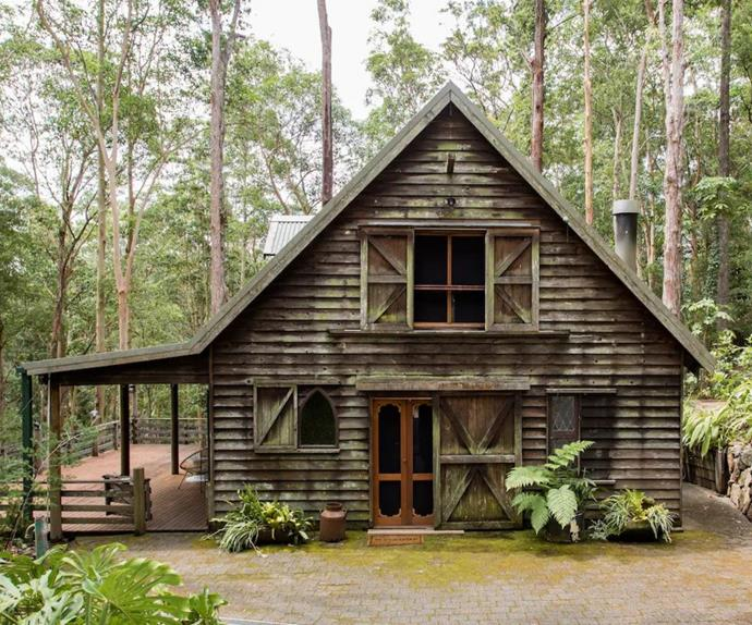 Exterior of rustic timber cabin in Bonogin, QLD