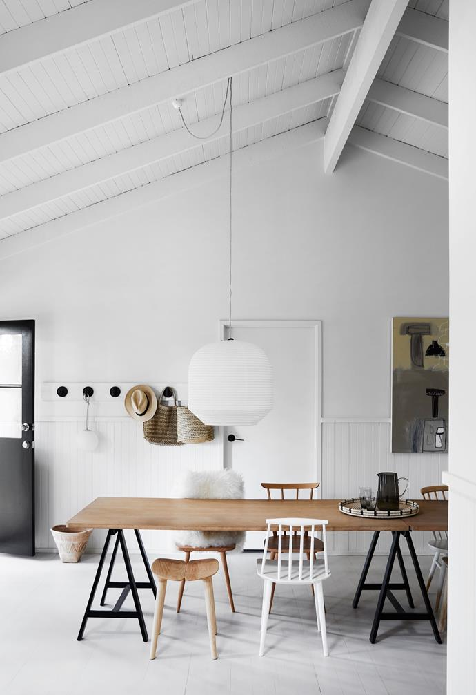 """The table was pieced together using Muuto tabletops and Ikea trestle legs, with a mix of Mattiazzi 'Osso' stools from District, a Temperature Design 'Ercol' love seat and chairs from Hay and Design Nation for seating. Two oversized Twentytwentyone 'Hotaru' lamps from Space are suspended over the [dining table](https://www.homestolove.com.au/10-of-the-best-dining-tables-13249