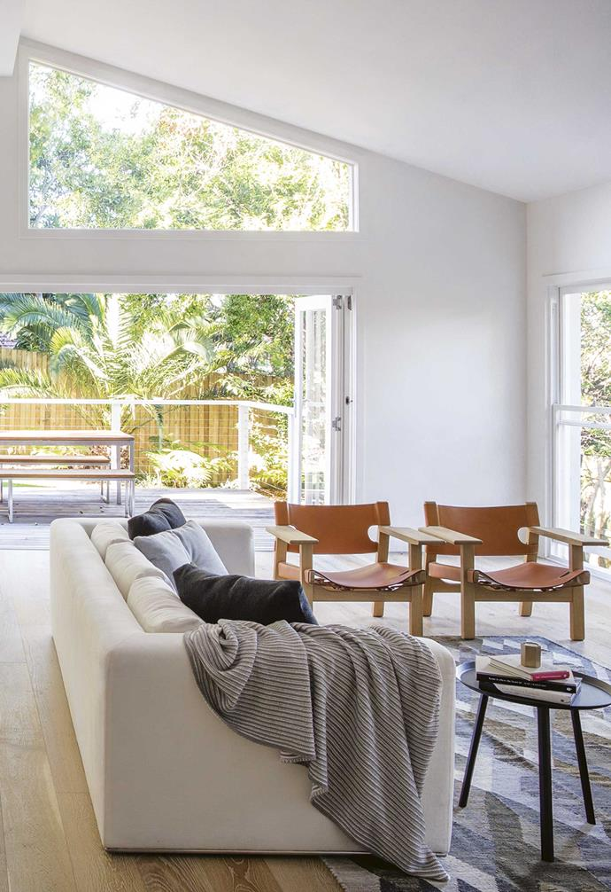 """**Living area** Vaulted ceilings and abundant light were top priorities for Judi and Al, and this space delivers all that and more. """"A connection to the garden was part of the original brief,"""" says designer Suzanne."""