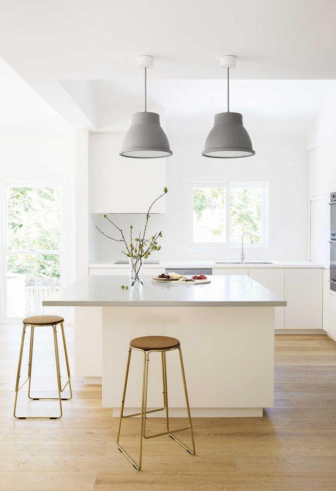 """**Kitchen** Muuto pendant lights illuminate Al's entertainer's zone, their tone complementing the Corian benchtop with stools from [Great Dane](https://greatdanefurniture.com/
