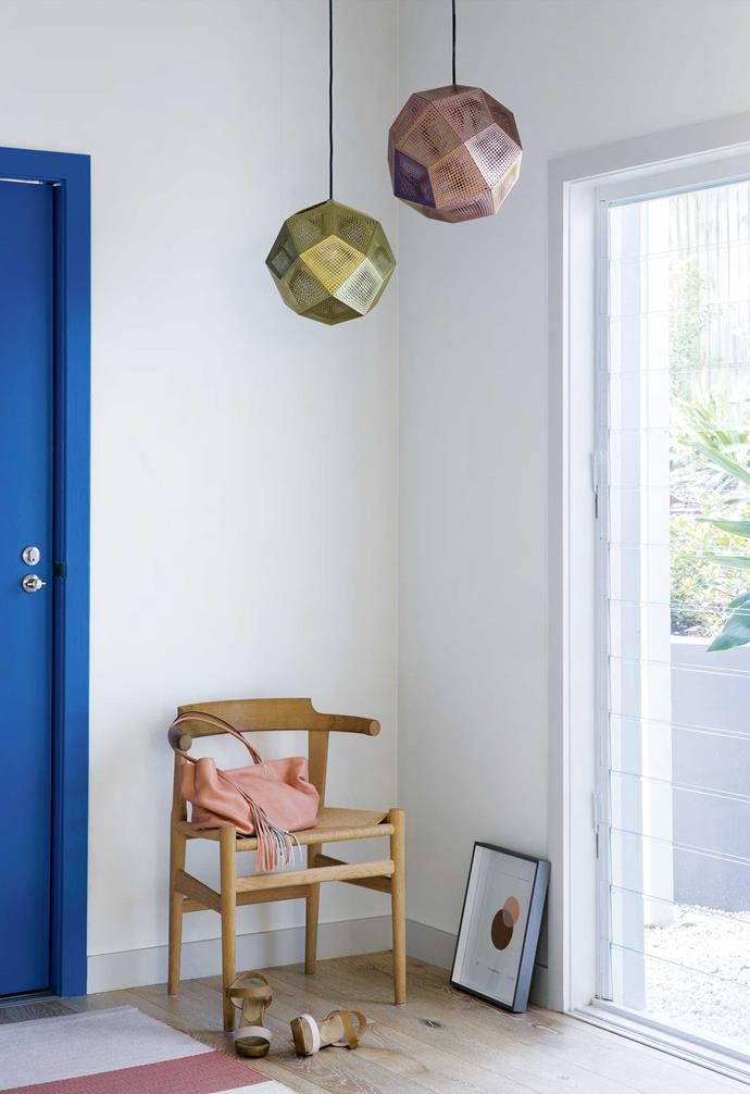 """**Entry** A 'PP68' chair by Hans J. Wegner sits ready to catch incoming handbags and car keys. Judi and Suzanne's moodboard featured a Mediterranean-style colour palette. The home's neutral base amps up the impact of the sporadic bursts of iconic Klein blue, such as on the front door. A [Rachel Castle](https://www.castleandthings.com.au/