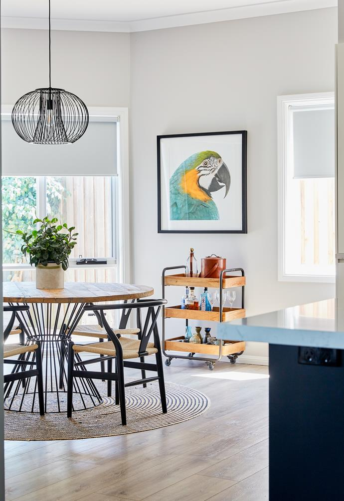 """A cheeky bird print from Designer Boys Art looks over the home's [casual dining space](https://www.homestolove.com.au/relaxed-dining-area-ideas-3675