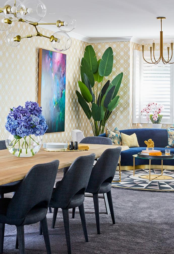 """A dining table and chairs from Globe West feature in the elegant formal [dining space](https://www.homestolove.com.au/relaxed-dining-area-ideas-3675