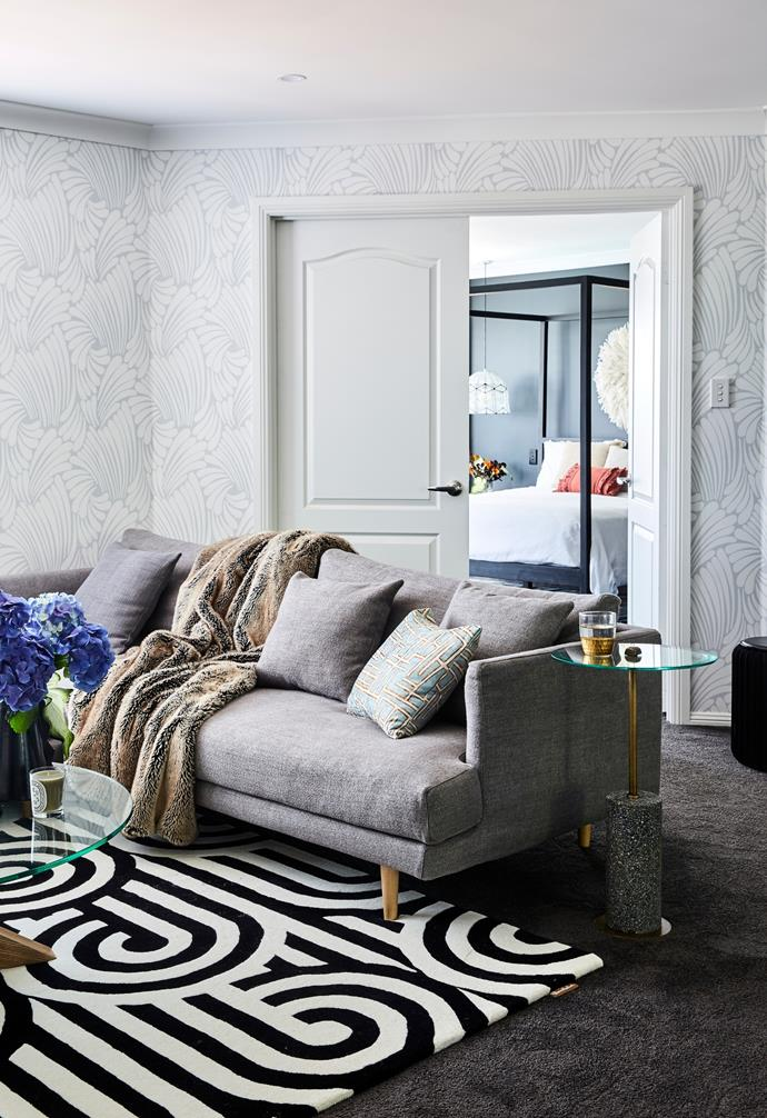 The 'Vittoria Mia' sofa from Globe West is a favourite in the upstairs living room. The teenagers' retreat is anchored by the striking 'Turnabouts' rug in Magpie by Florence Broadhurst from Materialised. The 'Hudson Round' coffee table from Globe West continues the circular theme.