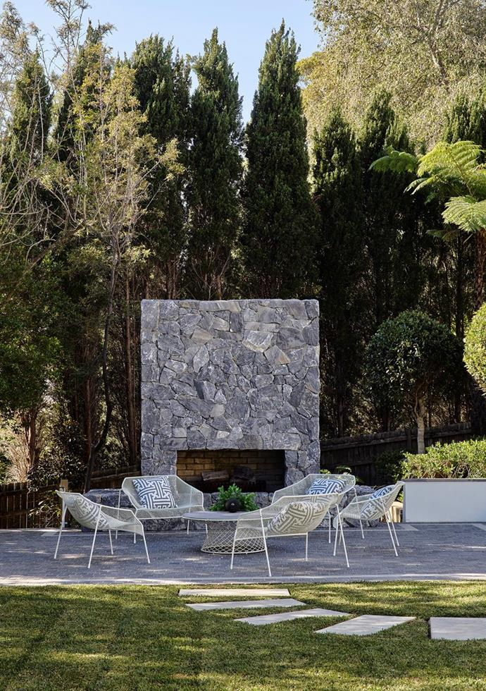 """Afternoon shade adds to the serenity of the outdoor fireplace terrace in the garden of this [glamorous Greg Natale designed home with art deco touches in Hunters Hill](https://www.homestolove.com.au/greg-natale-art-deco-inspired-home-hunters-hill-22330