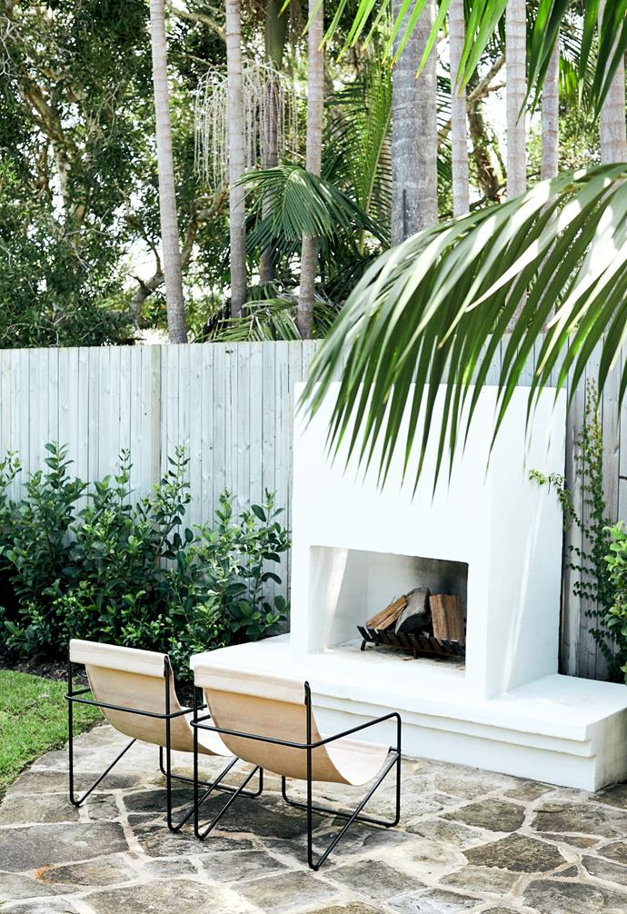 """A stylish white [outdoor fireplace](https://www.homestolove.com.au/outdoor-fireplace-ideas-21292
