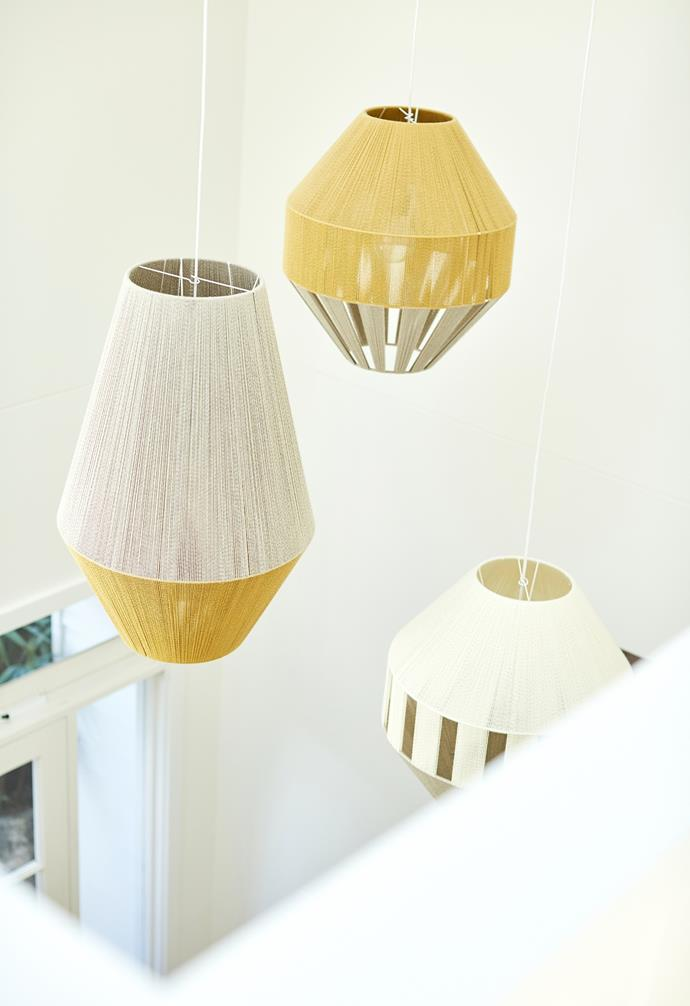 In the stairway to upstairs, striking yellow and white pendant lights fill the void and create a beautiful statement.