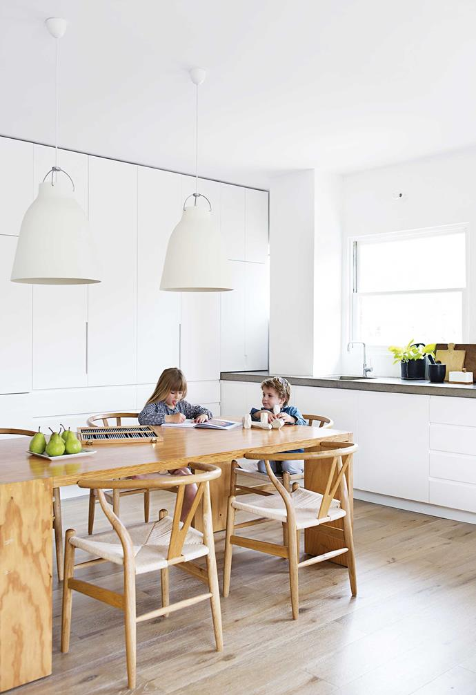 **Dining area** Lola and Jethro at the dining table, which is positioned in the heart of the home.