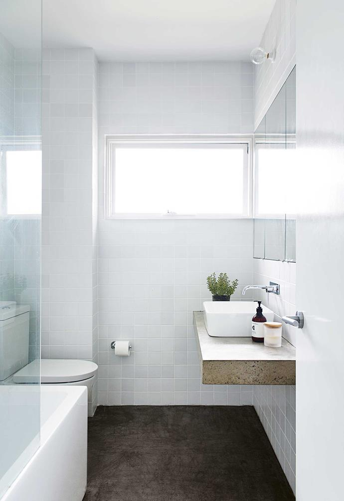 **Bathroom** Concrete also features in the wet zone, both as a counter and on the floor. Tiles from Amber Tiles and a recessed mirror cabinet reflect the apartment's overall simple yet sophisticated look.