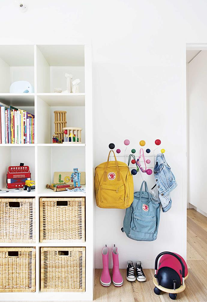 **Lola and Jethro's bedroom** An Eames Hang-It-All rack and IKEA bookcase, complete with baskets, keep toys, bags and books sorted.