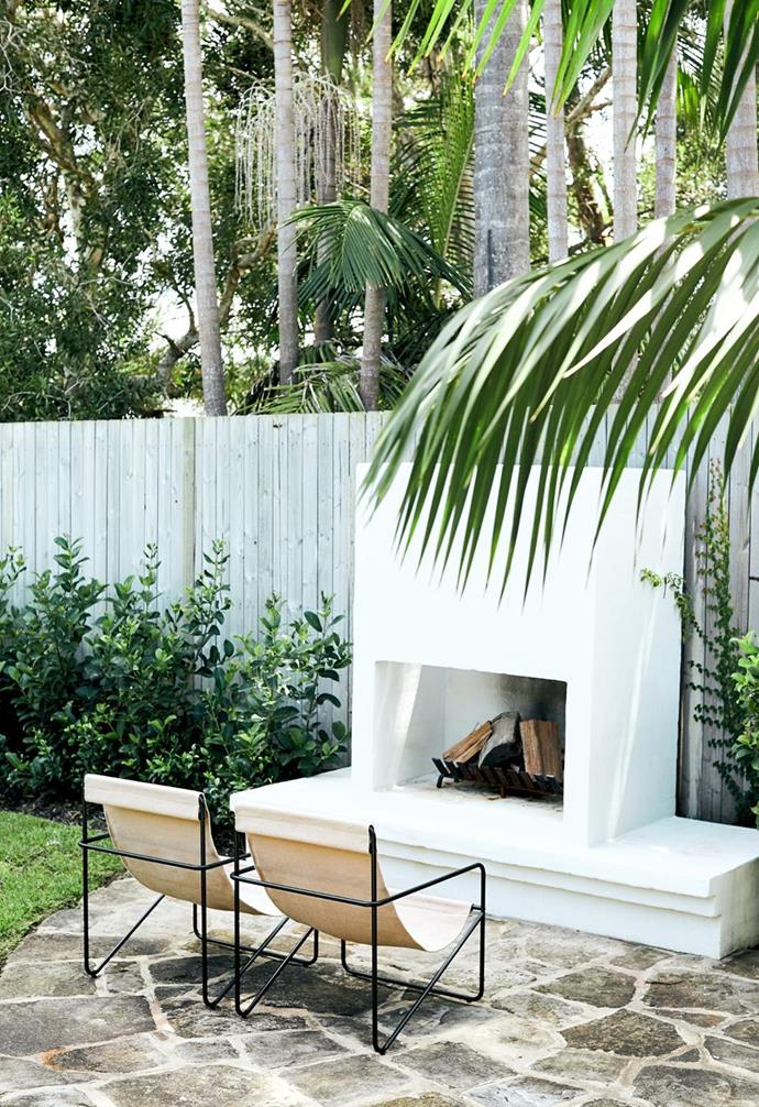 """A stylish white outdoor fireplace allows the owners of this [coastal haven on the Sydney Northern Beaches](https://www.homestolove.com.au/palm-beach-founder-home-22513
