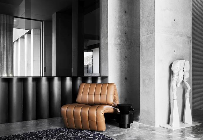 De Sede DS-266 recliner armchair, Wittmann 'Grain Cut' side table, both from Domo. Serendipity sculpture by Kylie Thomas.