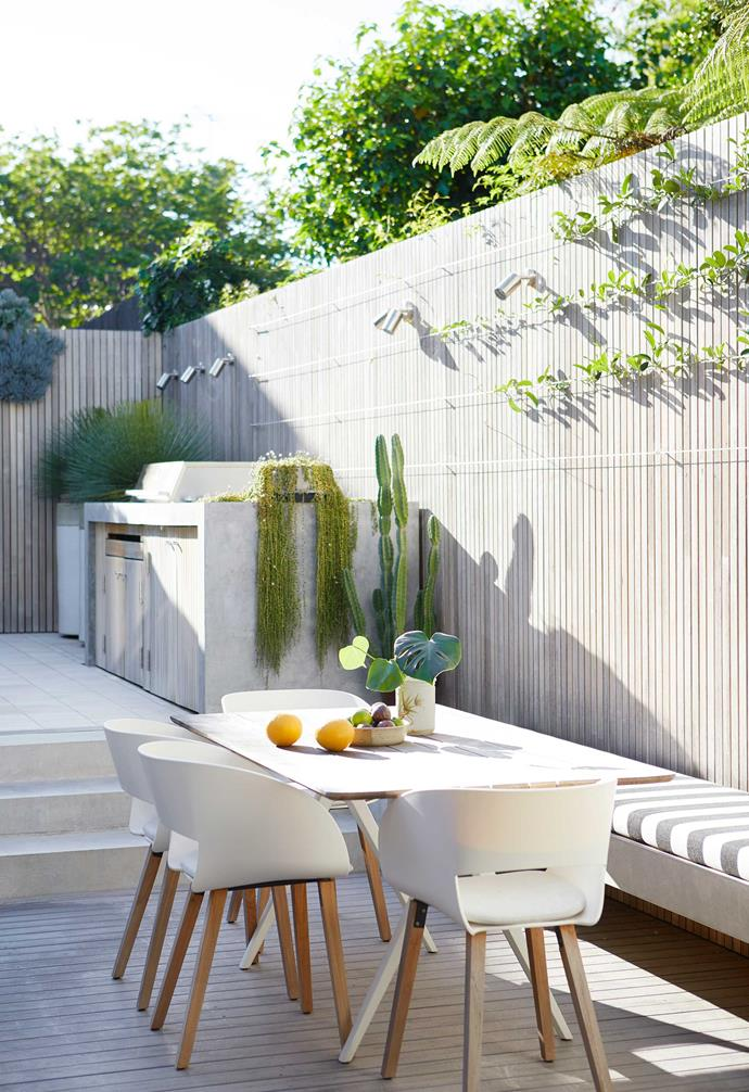 """Carefully curated surfaces and finishes do most of the heavy lifting, while the edited plantings are confined to robust, [easy-care grasses](https://www.homestolove.com.au/ornamental-grasses-australia-19276 target=""""_blank"""") and succulents. Copious strip-finished concrete does triple time as seating, steps and barbecue surround, creating a smooth flow from one level of the courtyard to the other."""