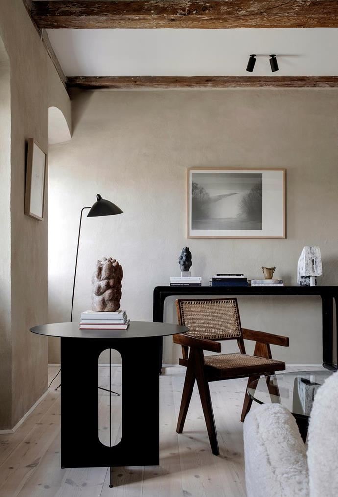 """Textured walls and quality timber furniture add a beautiful warmth throughout this [17th-century building in the heart of Copenhagen](https://www.homestolove.com.au/exposed-timber-beams-20584