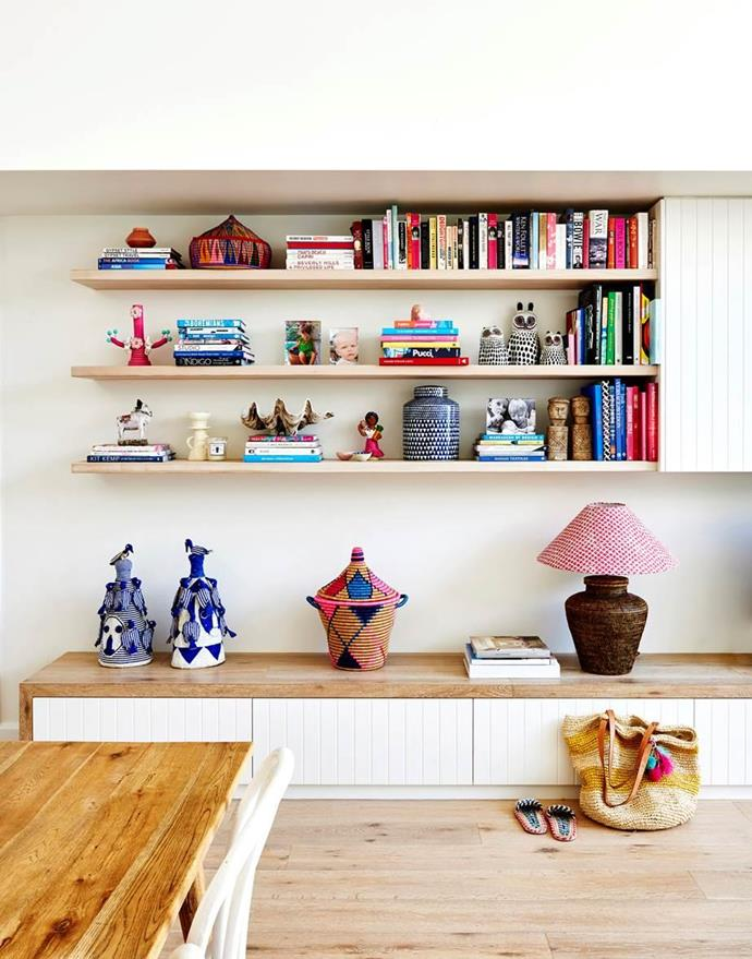 """Custom shelving and cabinetry in the living/dining area of this [colourful Byron Bay home](https://www.homestolove.com.au/coastal-cottage-byron-bay-20442