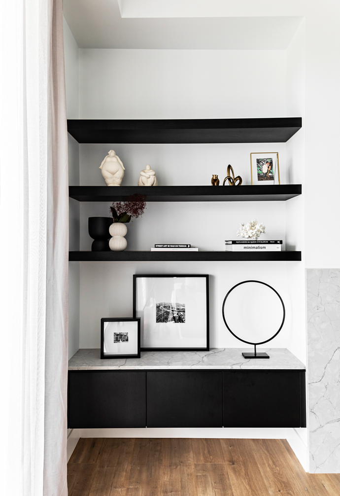 """Custom shelving in Polytec Woodmatt Black epitomises stylish storage of this [contemporary new-build home in Sydney's South West](https://www.homestolove.com.au/contemporary-family-new-build-sydney-22465