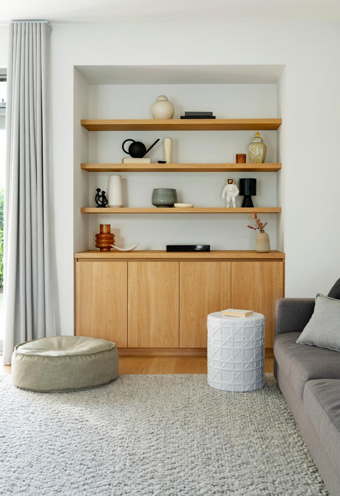 """A set of timber built-in shelves are built into a nook in the rumpus room of this [relaxed new-build in Perth](https://www.homestolove.com.au/contemporary-new-build-home-cottesloe-perth-22333