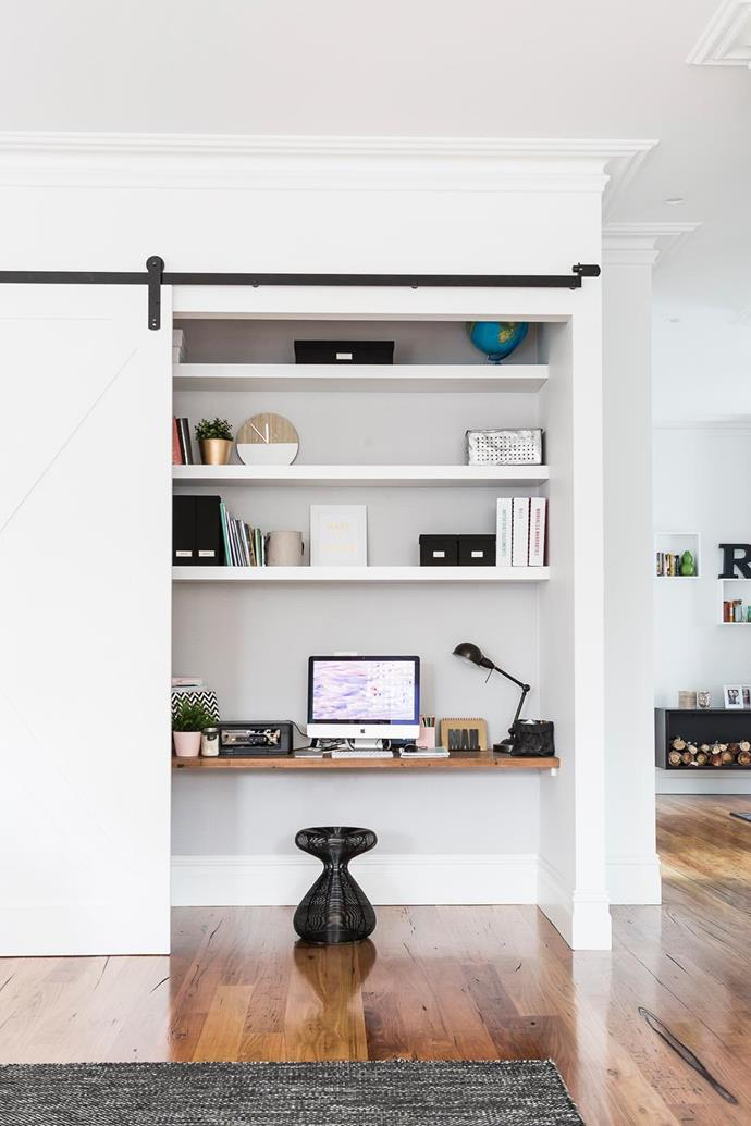 """This study nook is cleverly concealed behind a sliding door within a living room to make the perfect [multi-purpose space](https://www.homestolove.com.au/flexible-living-how-to-create-multi-purpose-spaces-1994
