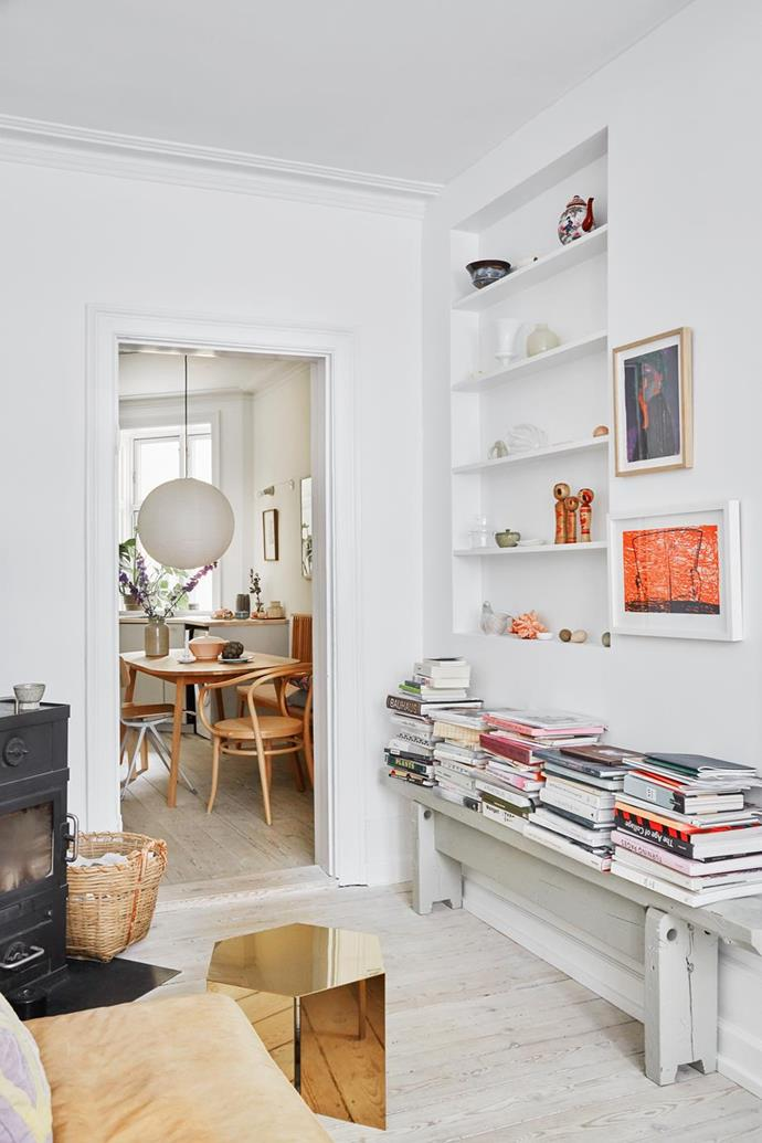 """No ledge is left bare in the living room of this [art director's Scandi apartment](https://www.homestolove.com.au/copenhagen-home-tour-21300