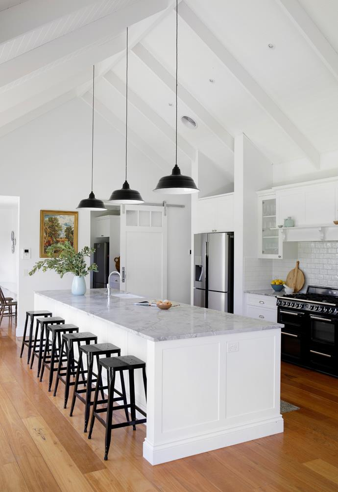 """All the action happens here. """"We asked our architects for the [raked ceiling](https://www.homestolove.com.au/exposed-ceiling-beams-17206