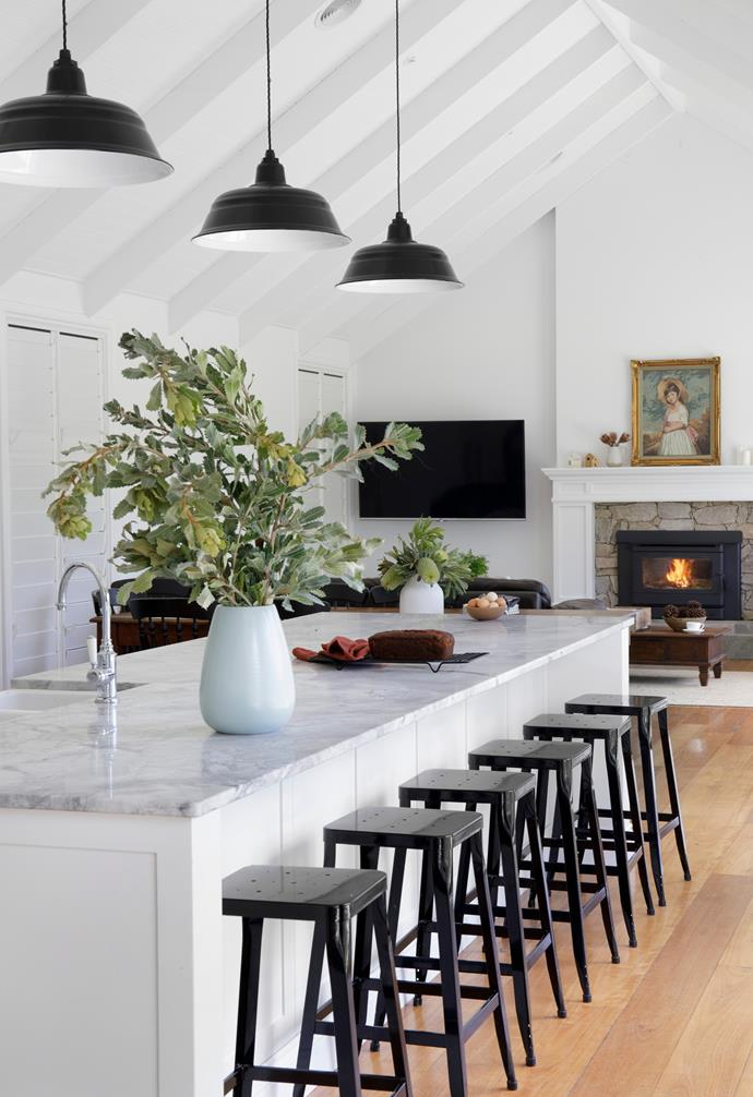 """Blackbutt floorboards from Finlayson's show natural knots and character, to help generate the country feel, as do [pendant lights](https://www.homestolove.com.au/pendant-light-shopping-guide-20225