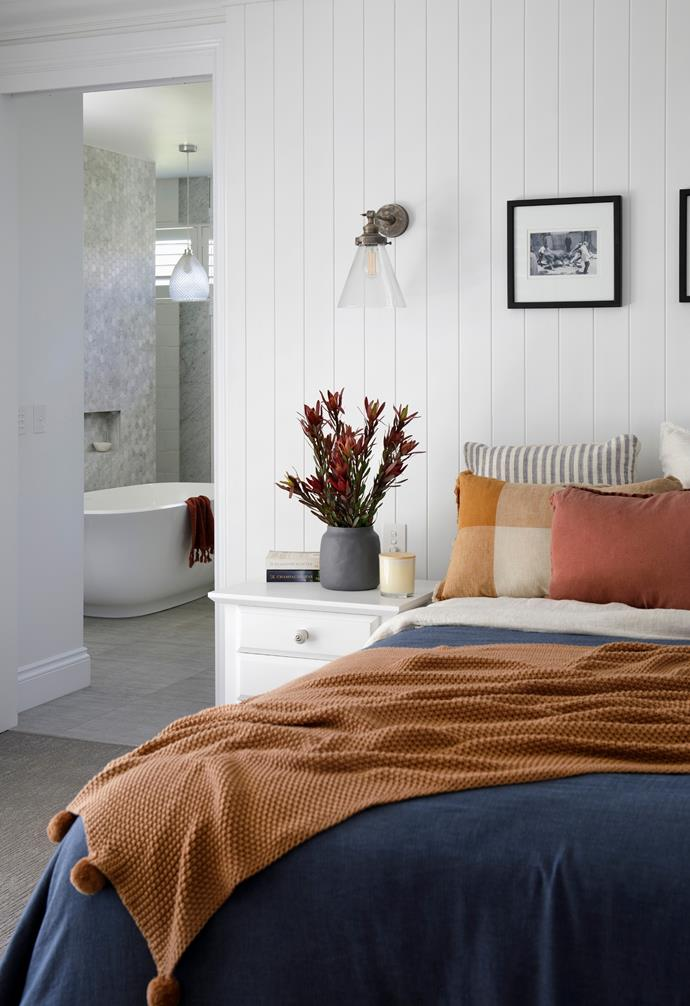 With bedrooms for the kids flowing off either side of the central hallway, Leanne and Rob claimed the prime spot at the end. A mix of linen and cushions from Adairs adds cosy layers to the bed, flanked by second-hand side tables refreshed by a coat of Dulux White On White and new handles. For similar handles, try DoUp.com.au. Above the bed, 'Francis' wall sconces from Interiors Online tick off bedtime reading in style, and framed photos from a European holiday add a personal touch