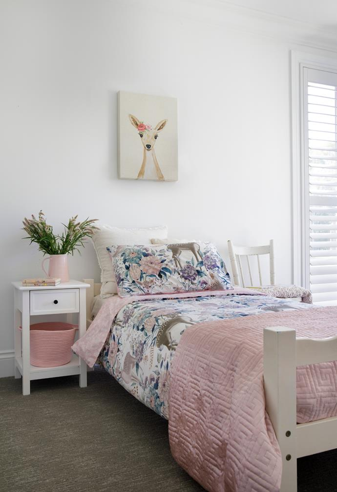 Eva's bedroom is dressed with bedlinen from Adairs and Kmart, where Leanne also found the pink basket.