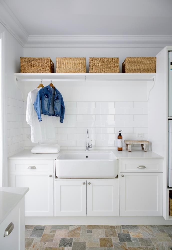The busy family laundry was kept simple and classic, with Dulux White On White walls, cabinetry in Dulux Lexicon Quarter, a subway-tile splashback, a benchtop in Caesarstone Frosty Carrina and a generous Shaws 'Classic' farmhouse sink (try Just Bathroomware), with Brodware 'Winslow' tapware.